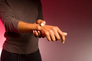 woman holding wrist arthritis joint stiffness