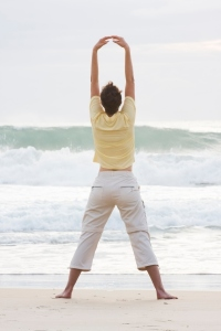 woman yoga on beach breathing qigong