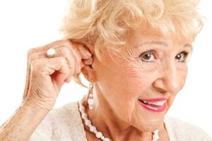 senior elderly women hearing aids