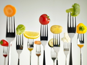 fruits and vegetables on forks food diet