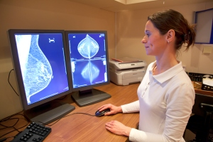 mammograms radiology tech examines