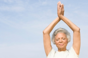 yoga pose exercise elderly African American black woman