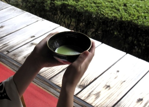 Japanese holding green tea